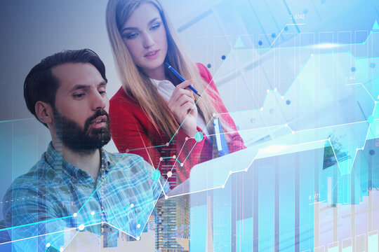 Man and woman with laptop in office, graph