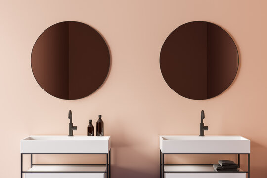 Beige bathroom interior with double sink, close up