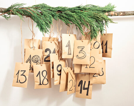 Handmade advent calendar. Gift bags hanging on the rope. Eco friendly Christmas gifts diy
