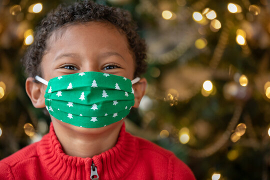 Adorable Black Boy Wearing a Christmas COVID-19 Cloth Face Mask Smiling with His Eyes