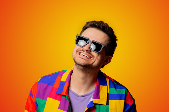 style guy in 90s shirt and pixel sunglasses on yellow background