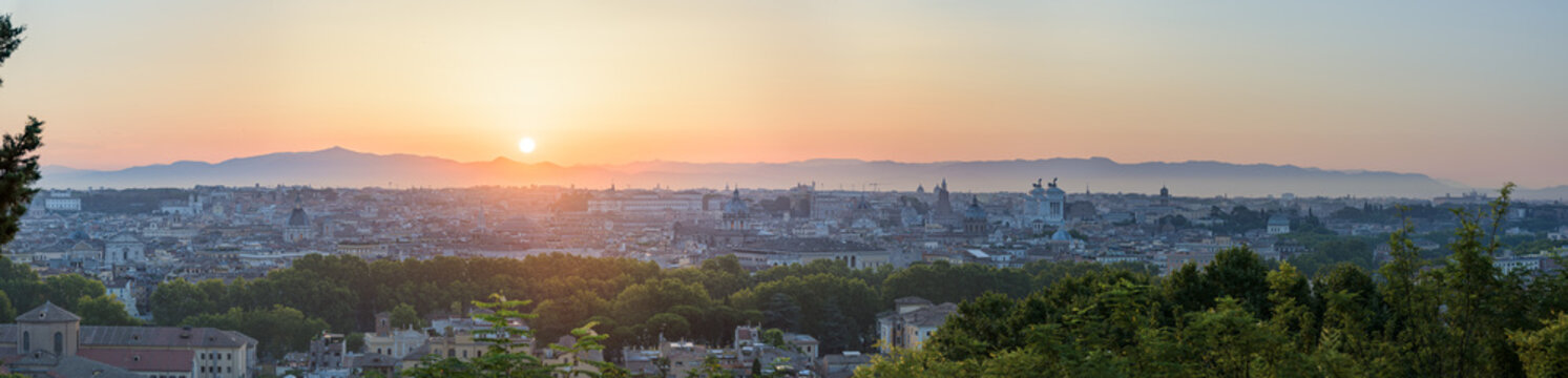 Panorama of Rome, Italy at sunrise from Janiculum Hill viewpoint: Trastevere, Villa Medici, Spanish Steps, Pantheon, Victor Emmanuel monument, Saint John Lateran, Colosseum, Roman Forum, historic city