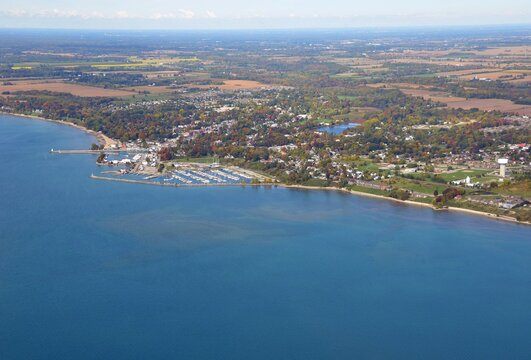 Aerial view from above Lake Erie towards the shoreline near the small town of Port Dover home of Friday the 13th biker meets, Autumn Season colors; Ontario Canada