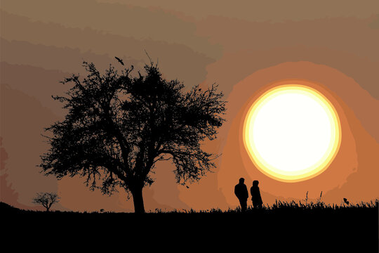 Silhouette of a couple taking a walk at sunset