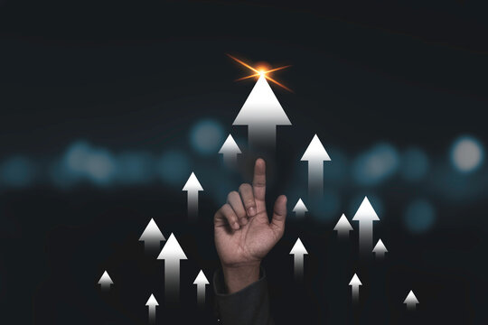 Hand rise up with increasing arrow for business growth and profit increase concept.