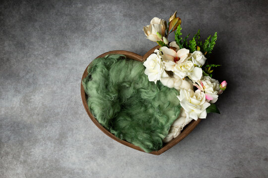 heart made of wood, decorated with roses. basket for a newborn photo shoot. white rose. heart