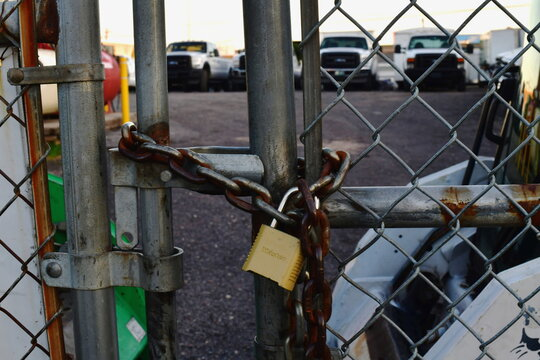 A lock fastens a chained link fence at Four Seasons Landscaping, the location of a press conference with President Donald Trump's legal team yesterday in Philadelphia