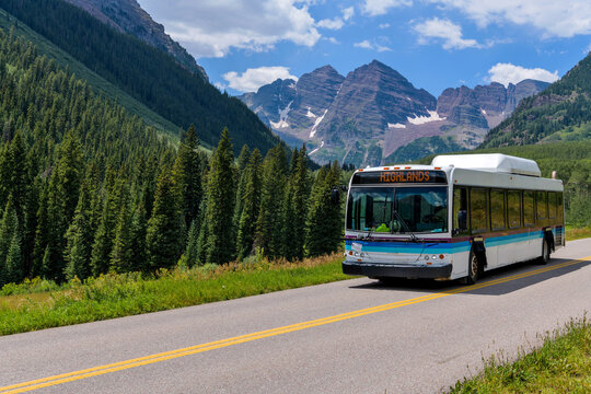 Shuttle at Maroon Bells - During daytime hours of Summer and Autumn, Shuttle buses, running between Highlands and Marron Lake, are only vehicles allowed into Maroon Bells Scenic Area.  Aspen, CO, USA.