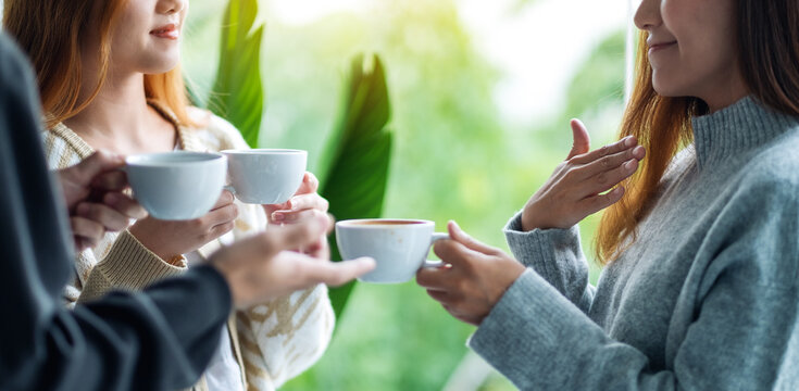 Close up image of people enjoyed talking and drinking coffee together
