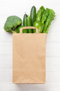 Different green healthy food in recycling paper