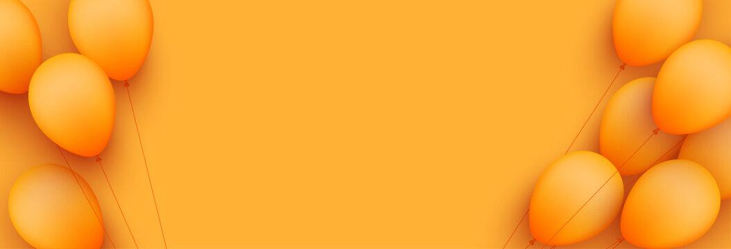 Orange balloons with threads on orange background.