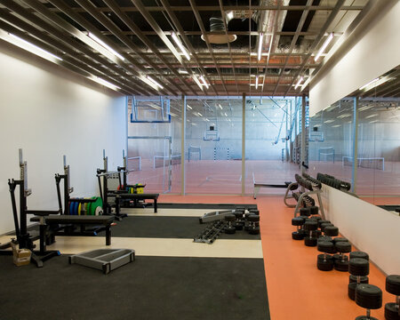 Weight Room in a Gymnasium with equipment and weights