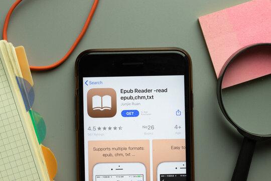 New York, USA - 26 October 2020: Epub Reader read epub chm txt mobile app logo on phone screen close up, Illustrative Editorial