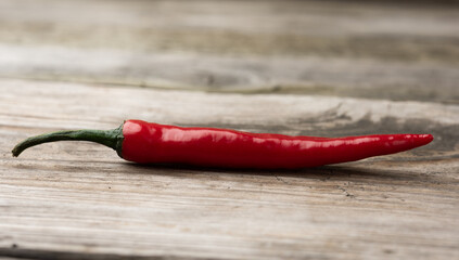 pod of red chili pepper on a gray wooden board