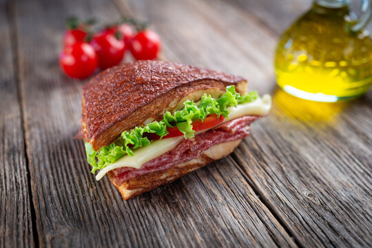 Assorted sandwiches on wooden background