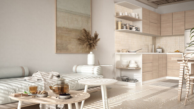 Cosy wooden sustainable kitchen and living room in beige tones with modern sofa and coffee tables. Tea time, glass teapot and teacup, snacks. Environmental friendly interior design