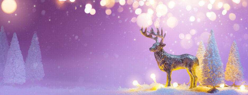 Christmas banner background with santas reindeer and snowy tree decoration