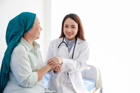 Female doctor encourage with patient cancer in medical office. Support people living with tumor illness.