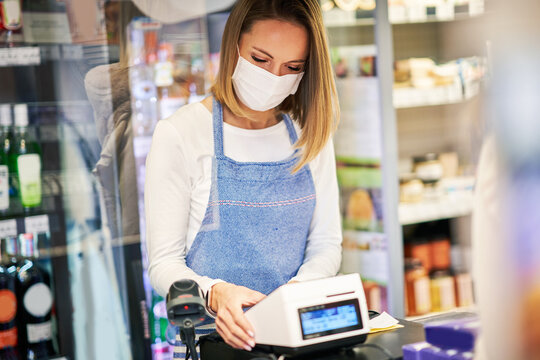 Shop assistant working in medical mask