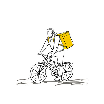 Bicycle courier in a protective mask during an epidemic Covid.