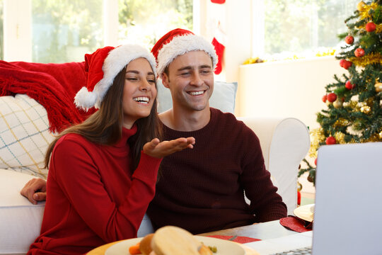 Caucasian couple at home together making a video call at christmas