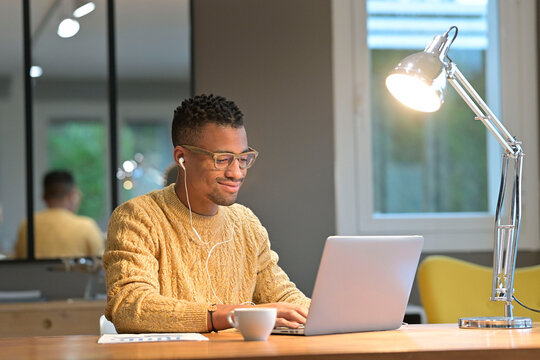 Portrait of african american trendy guy in a distant online call