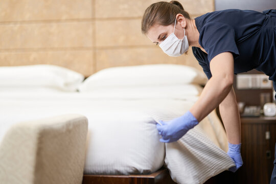 Housekeeping staff cleaning room before customers arrival