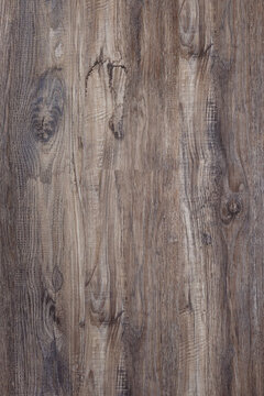 Hardwood laminate floor viewed from above for natural texture and background.