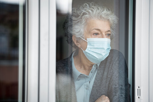 Depressed senior woman in quarantine at home suffers from loneliness