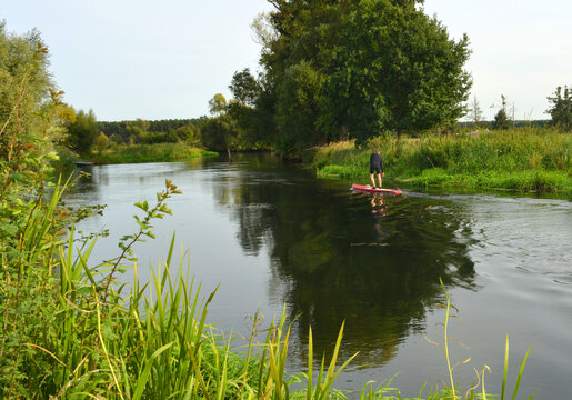Stand up paddle sport on a river in Germany