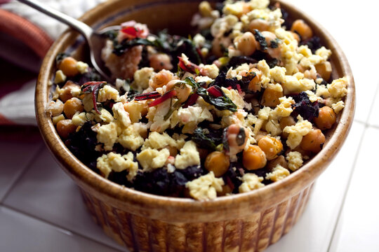 Bulgur with Swiss chard, chickpeas and feta in bowl