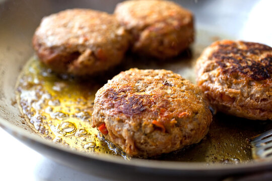 Close up of Turkey burger fried in pan