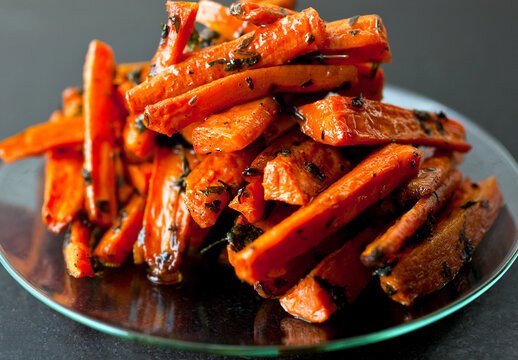 Roasted carrots with parsley and thyme on plate