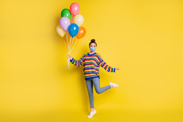 Full size photo of brunette girl hold balloons wear blue mask from corona rainbow sweater isolated...