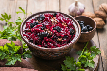 Christmas salad with beets, prunes and nuts