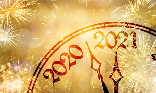 New Year clock near to the midnight of 2020, fireworks golden bokeh