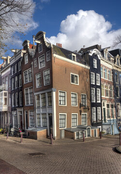 Street with historical  houses iin Amsterdam, Holland