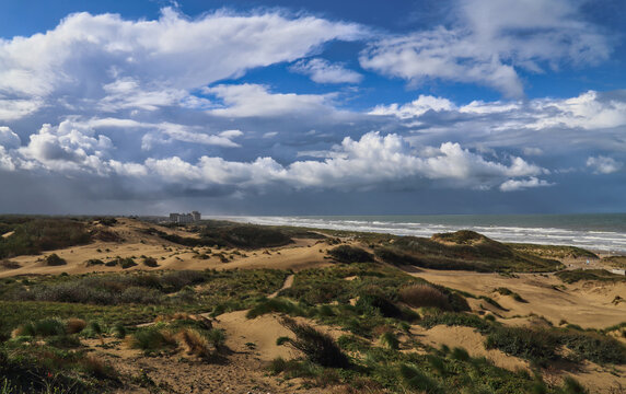 Dunes and clouds at Kijkduin in The Hague, Holland