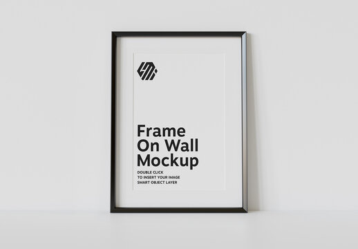 Vertical Black Frame Leaning on White Interior Mockup