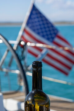 a bottle of wine on the background of the American flag