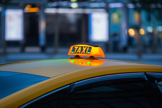 illuminated sign taxi on the roof of the car