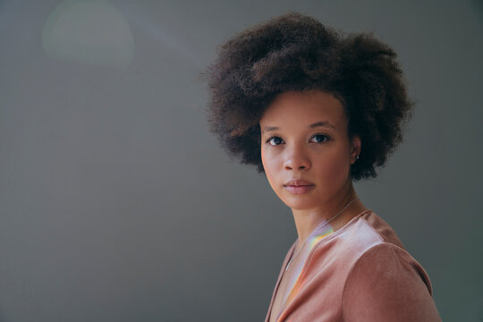Portrait of confident beautiful woman with afro