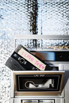 """""""I Love You"""" mix tape in boom box, vertical"""