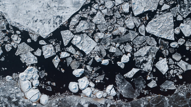 drone view: ice floes on the river in winter