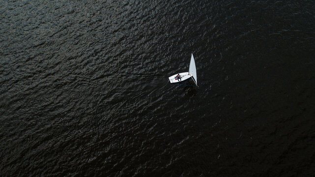 Lonely small white yacht drone shot
