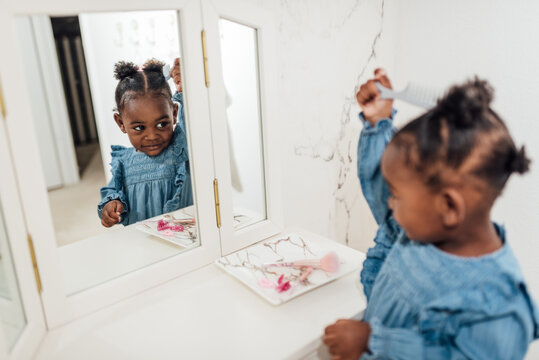 Little Girl Playing with makeup