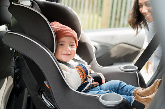 Baby smiling while sitting in car seat