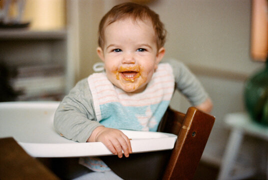 one year old mouth full of spaghetti