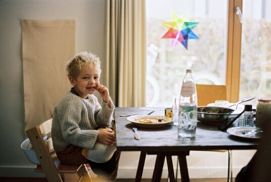 Toddler boy at a kitchen table