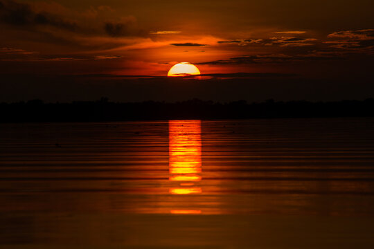 View of the sun falling on the sea horizon in a sunset